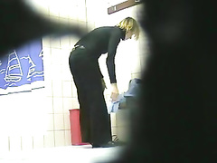 Fantastic short-haired blonde filmed while changing clothes