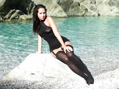 Magnificent dark-haired goddess has sex on the beach