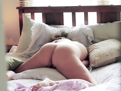 Sister wildly rubs her pussy while in the bed