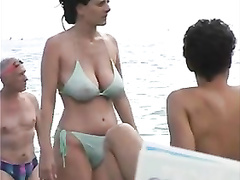 Busty raven-haired filly's nipples protrude from her bikini top